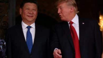 صورة تباين اقتصاد الصين والولايات المتحدة حول الاستجابة لفيروس كورونا
